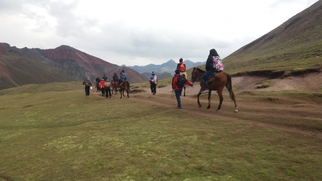 riding horse to Huchuy Qosqo Inca site from Cusco