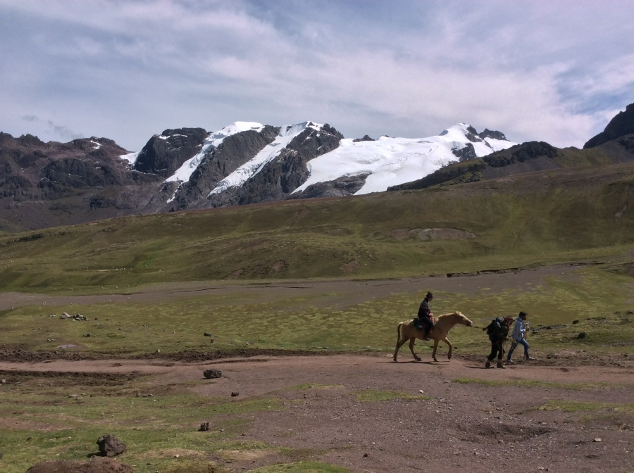 riding horses through Lares trek Cusco